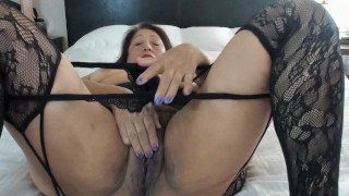 Sexy mature woman feeling quite satisfied after masturbating & orgasming