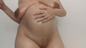 Pregnant Lena oiled body and pussy tease