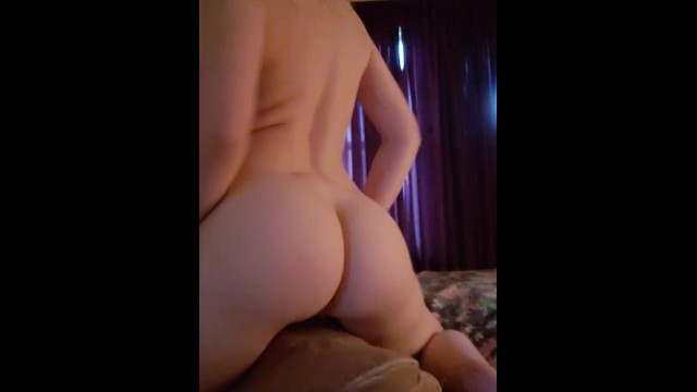 Slim brunette shows you her ass & humps her pillow(back view)