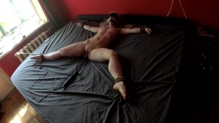 Girl tied to bed for vibrator torture