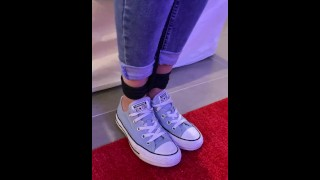 Girl with blue converse and tight jeans tied up by rope