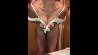 Hot MILF performs a little strip tease before putting on her bathing suit.