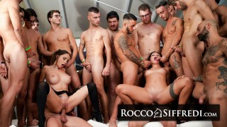 Screen Capture of Video Titled: RoccoSiffredi Two Babes Get Destroyed By A Huge Group Of Guys In An Amazing Gangbang