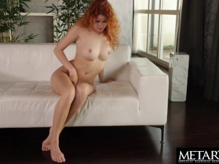 Gorgeous redhead in sexy lingerie plays with her hot shaved pussy