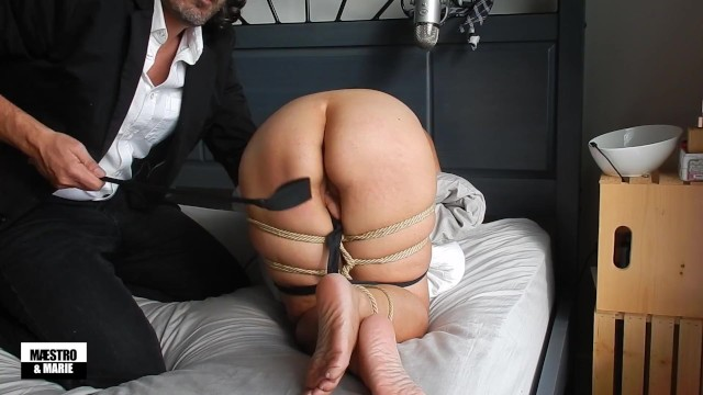 Maestro rope ties and spanks amateur MILF Marie's ass and feet with a riding crop