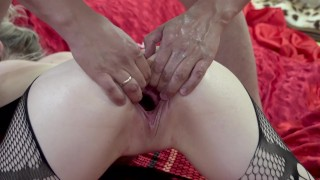 The wife experiences multiple orgasms from fisting.