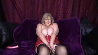 Busty Milf has a red leather finger fuck