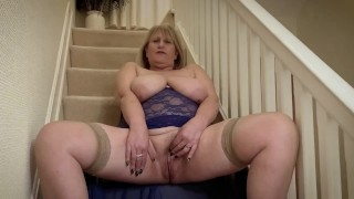Nasty Big Tit mature in stockings Fingers herself to climax on stairs.