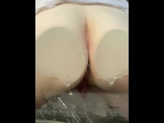 Bubble Butt Slut Spreads Her Cheeks Against Glass and Pisses, Playing With Herself While She Does