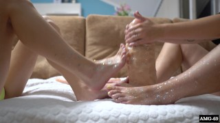 Two Cuties With Shiny Legs Play with Huge Rubber Cock - Footjob