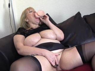 Mature Big Tit Milf in Stockings tests out her New Dildo in her very Wet Pussy.