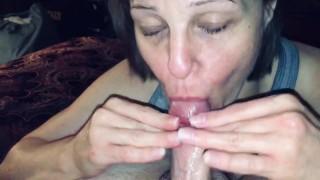 Mature sucking her man off