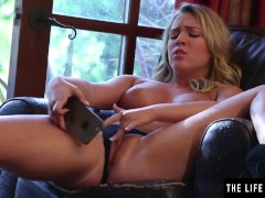 Cute blonde in sexy lingerie takes selfies while she masturbates