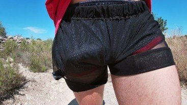 Erect cock walking in sport shorts