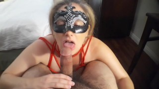Bitch with tied up tits sucks cock till it cumes all over her