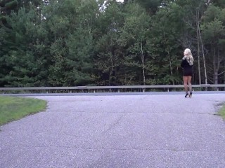 Sexy short tight dress and high heels hitchhiking.