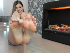 Hot footjob near the fireplace