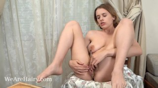 Anolia paints and strips naked on her chair