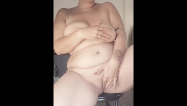 Chubby girl masturbates in front of window