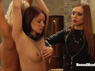 Dominant Madame In Leather Whipping Two Tied Lesbian Slaves
