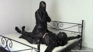 Bondage sex in leather coats