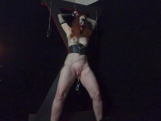 Redhead Milf tied to St. Andrews Cross and brought to orgasm.