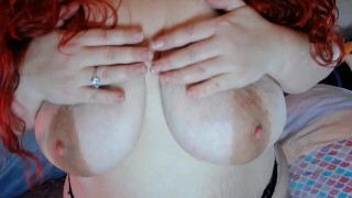 Pale redhead bounces massive tits and nipples