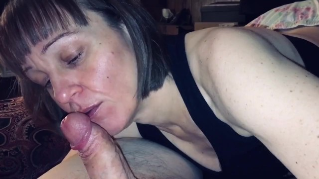 Step mom sucking her step son dry. Cum oozing from the corners of her mouth