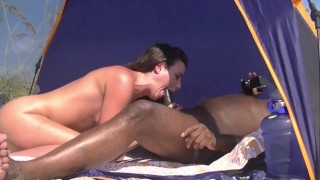 Screen Capture of Video Titled: Caribbean Nude Beach Interracial Sex #1 Voyeur Asks If He Can Watch Her And Jerk Off!
