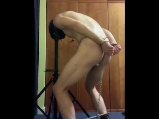 Hooded, plugged, naked subbie in horrible stress position bondage