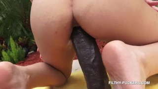 Screen Capture of Video Titled: Fisting and Stuffing my Step-Sister Riley Jean with a Ridiculously Big Black Dildo Outdoors 4K