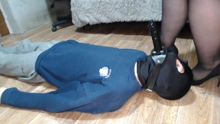 Slave satisfies Mistress with a dildo gag