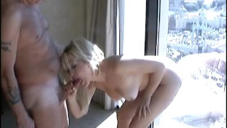 Using stick on dildo in Vegas hotel window and sucking cock