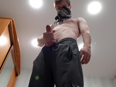 Chav lad jerks off a big cock in sweatpants and black sneakers