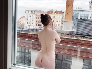 She smokes naked on the balcony, gives a blowjob and has sex. KleoModel