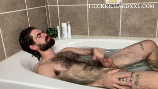 Hairy Hung Stud Takes Bath Rubs Body Hair Strokes Thick Cock