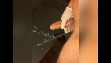 Uncut Latino squirts on glass table