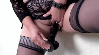 Sexy Stepmom stretchers her pussy with thick black Dildo