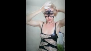 Foamy washing natural blonde hair in wet black dress. Angel Fowler