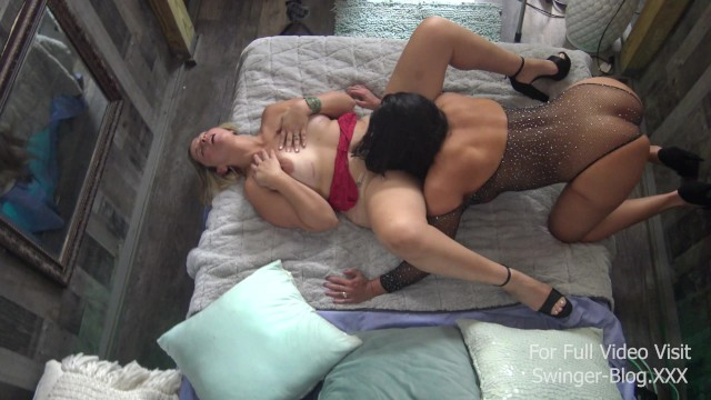 Busty swinger MILFs licking and toying each others wet pussies