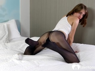 Smoking college girl teases with black pantyhose