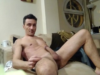 Exhibiting my fit body and big cock on a couch in a masturbation show