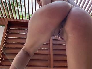Hot brunette Masturbates with the shower cream in the street shower