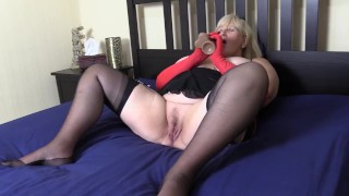 Filthy Big Tit Stepmom in stockings and red gloves fucks herself with thick veiny Dildo