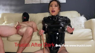 The Flossinatrix Trucici, clad in black leather, gives her sub a humiliating small dick rating