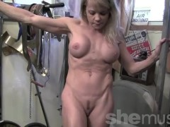 Muscular blonde showing off her muscles and more