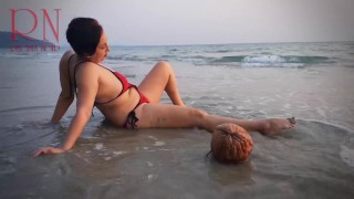 Nice lady at lonely nudist beach. Red swimsuit. Red bikini. Coconut