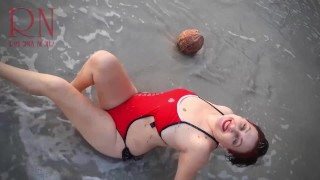 Nice lady at lonely nudist beach. Red swimsuit. Red bikini. Coconut has vagina!