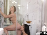 Sexy lesbian lovers go wild in the shower licking each others dripping wet pussies