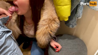 Blowjob in the fitting room while the consultant is outside the door